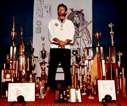 Jim with trophies